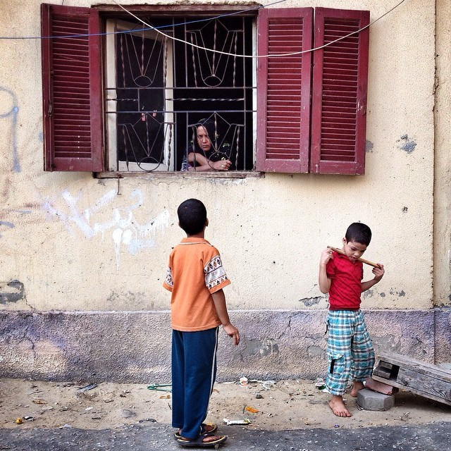 An Egyptian woman talks with her kids playing by the window in Nasr City, Cairo, Egypt, on Oct. 17, 2014. Photo by @Panchaoyue // @Every Day Egypt